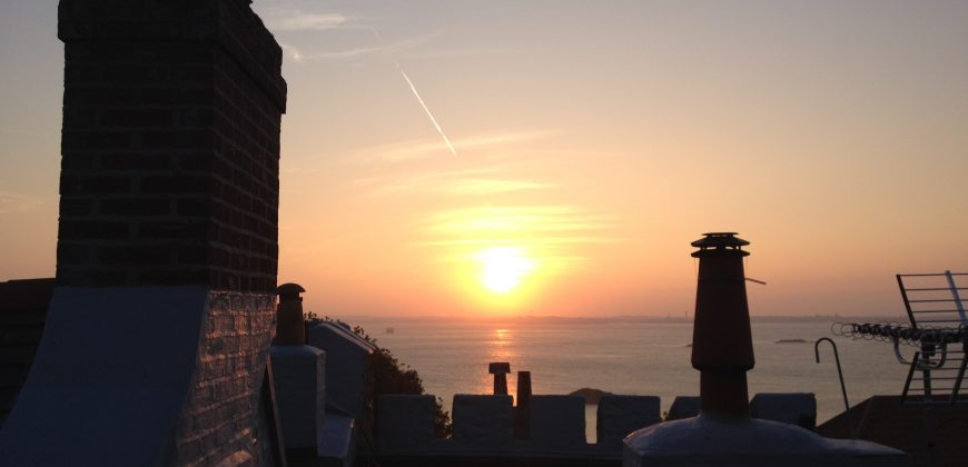 Sunset from Upper Keep apartment, looking towards Guernsey