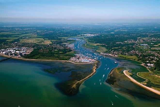 Aerial view of the river Hamble, showing the sandbanks, meandering river, marinas, houses and fields