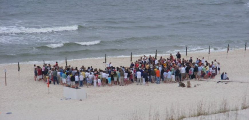 A group of people on the beach for the Easter Sunday service
