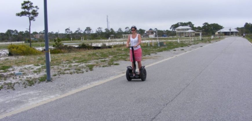 Me on a Segway riding along a paved road