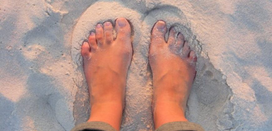 My feet in pink sunset sand
