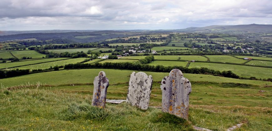 Exeter hills, with ancient gravestones overlooking rolling green hills and small villages