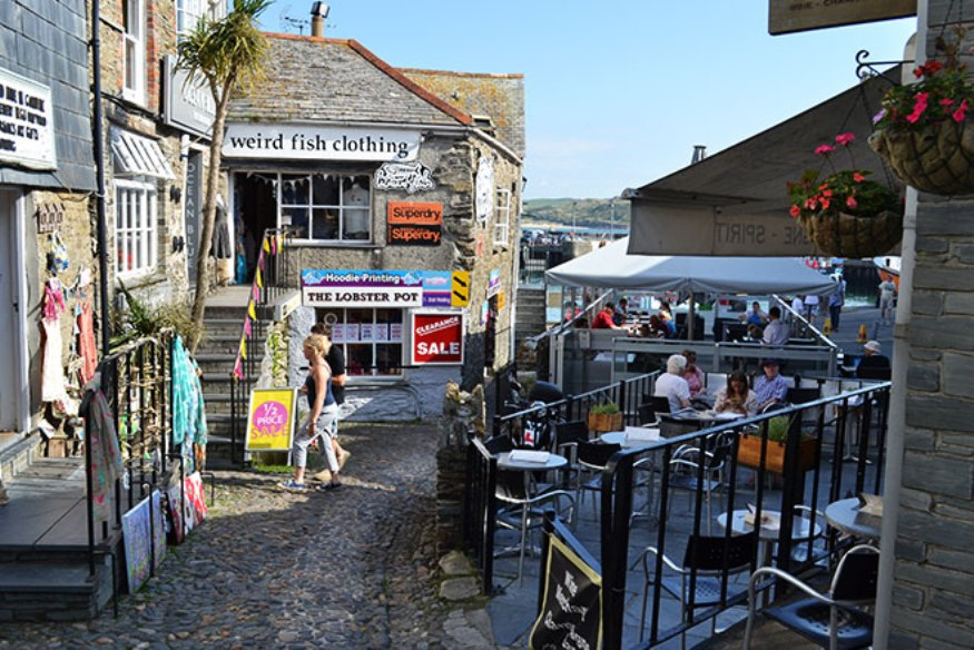Padstow village centre with a little cafe terrace, cobbled streets and small shops trading from old stone Devon cottages
