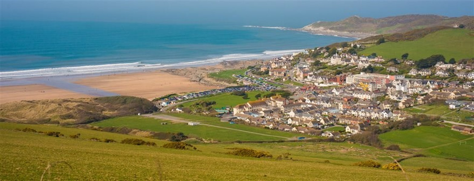 Woolacombe taken from the southern hills. The small town is surrounded by hills and overlooks a big sandy beach and clear seas