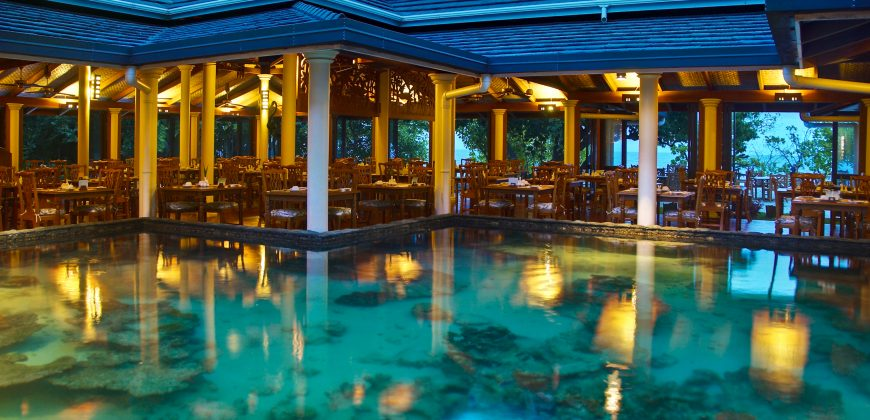 The main restaurant, with the coral feature in the middle, home to several lobster
