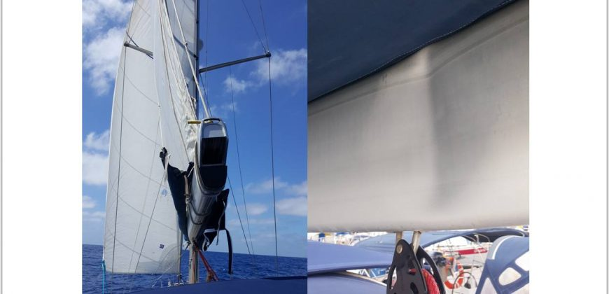 The bent boom pictured from two angles - the back of the boat and close up