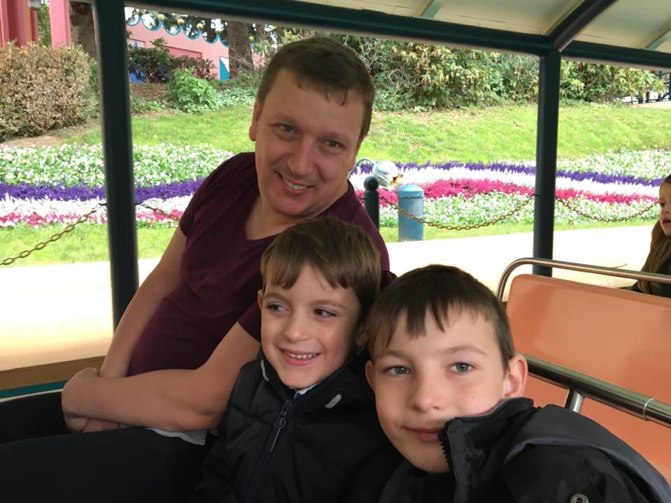 Guest blogger David with his sons in a tram at Disneyland