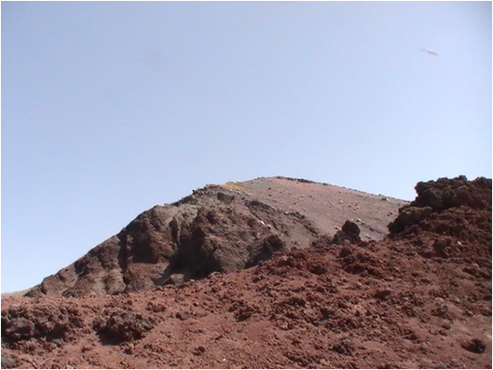 Mount Vesuvius, red brown soil against blue skies