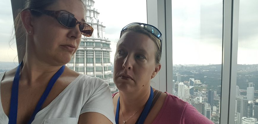 Lucy and I looking miserable at the top of the Petronas Towers
