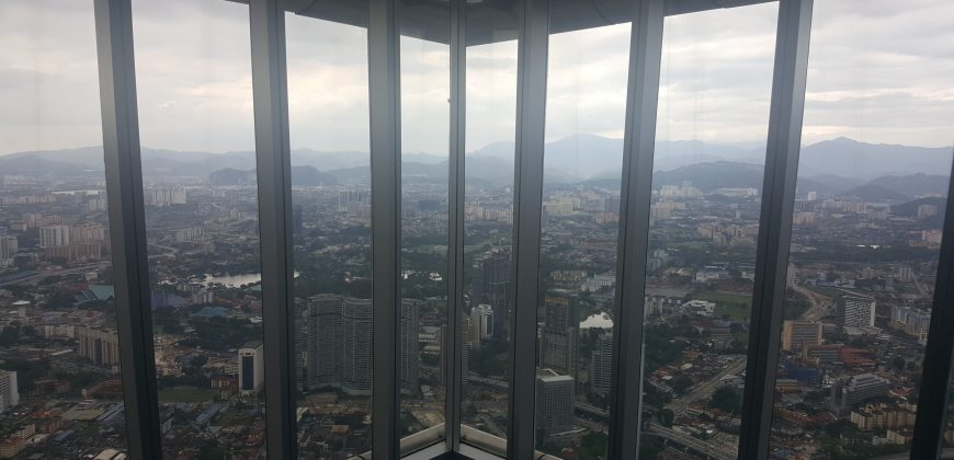 A rather dull view from the Petronas Towers, of average looking buildings stretching to the horizon