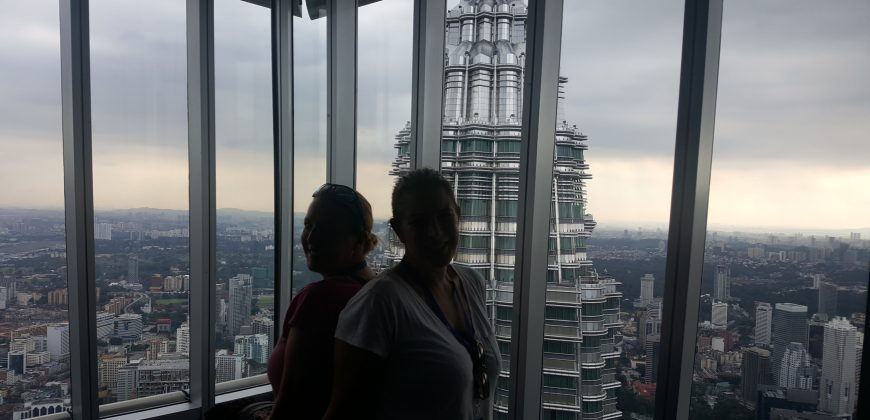 Lucy and I sat back to back on a sofa at the top of the Petronas Towers, with the city skyline in the background