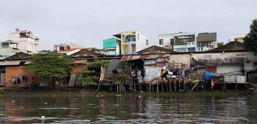 Rickety wooden stilt houses built over the river