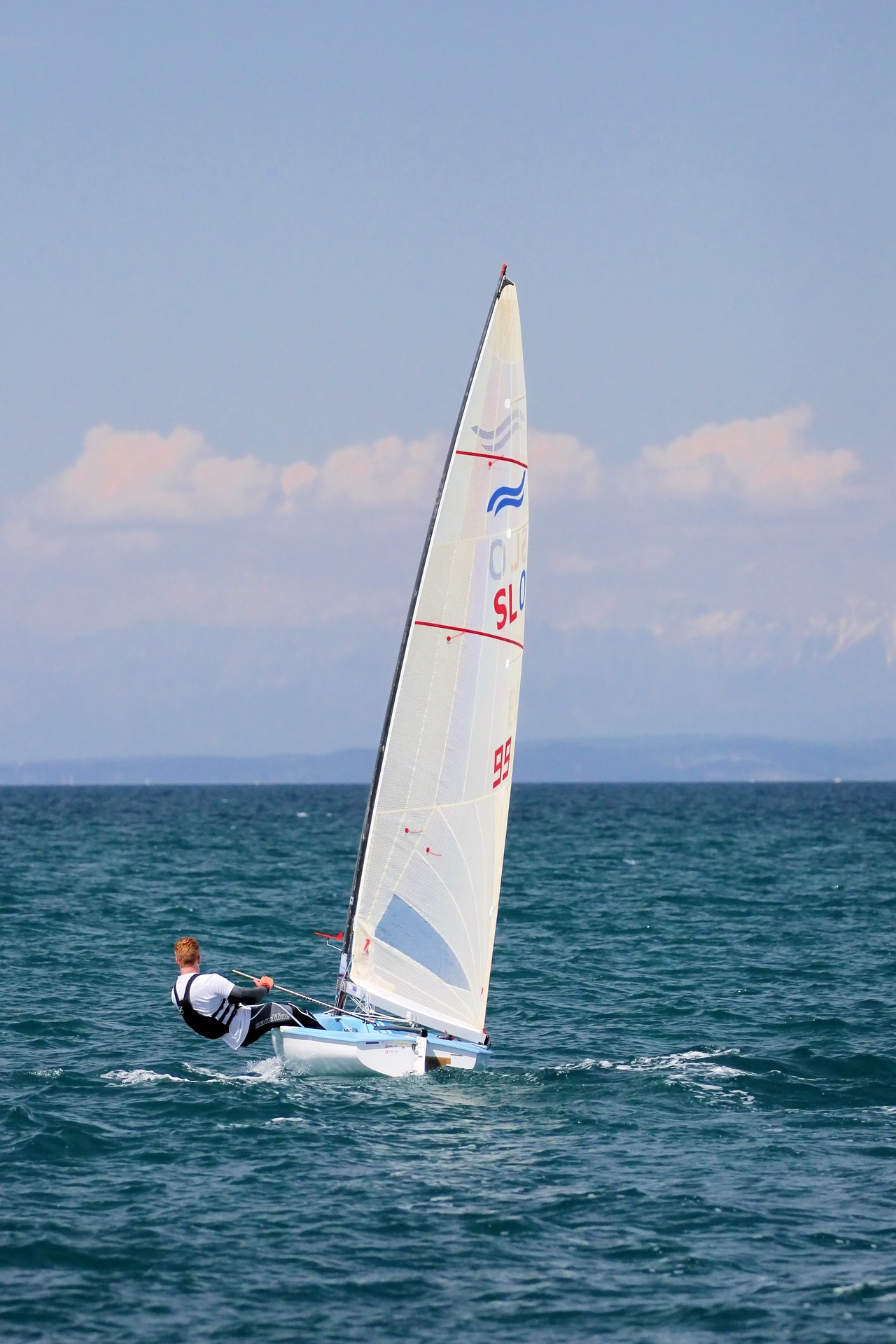 A small dinghy being sailed on the sea