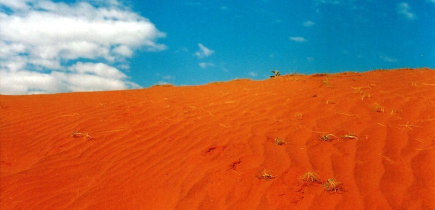 Bright orange sand set against a blue sky