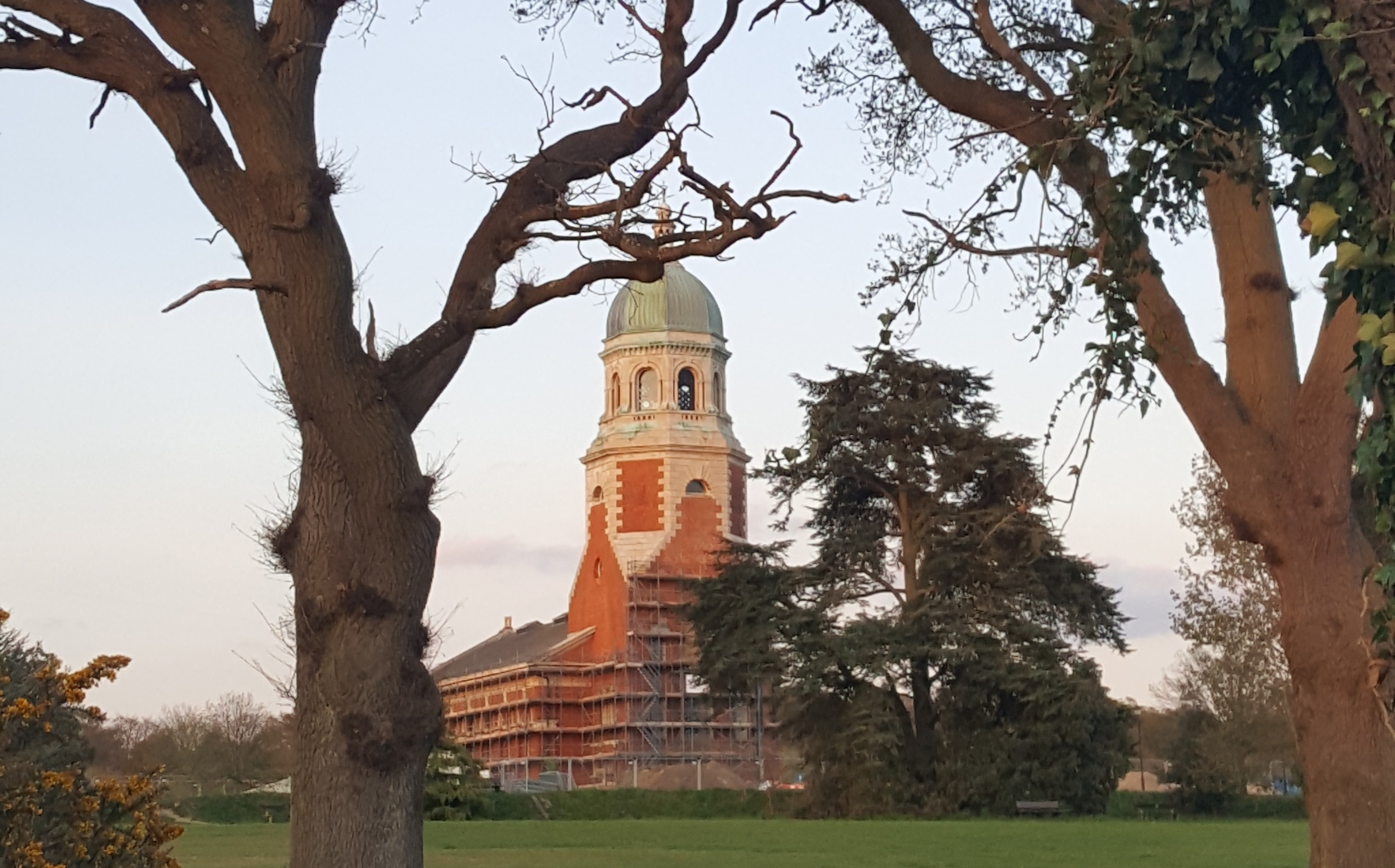 Netley Abbey, a grand Victorian style building set in a large park with mature trees