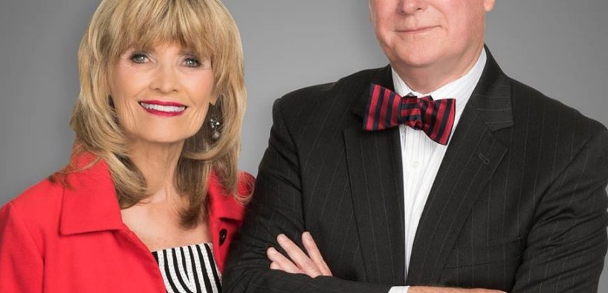 Seymour and Mary Jo West, wearing smart clothes. This is their professional company real estate photo