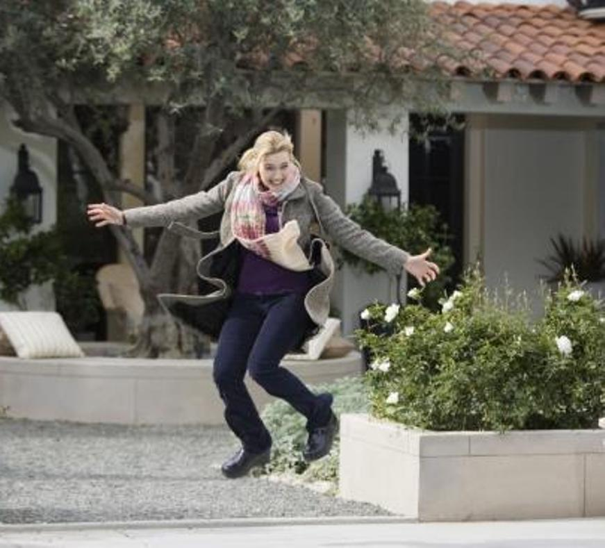 Kate Winslet jumping for joy in the film The Holiday