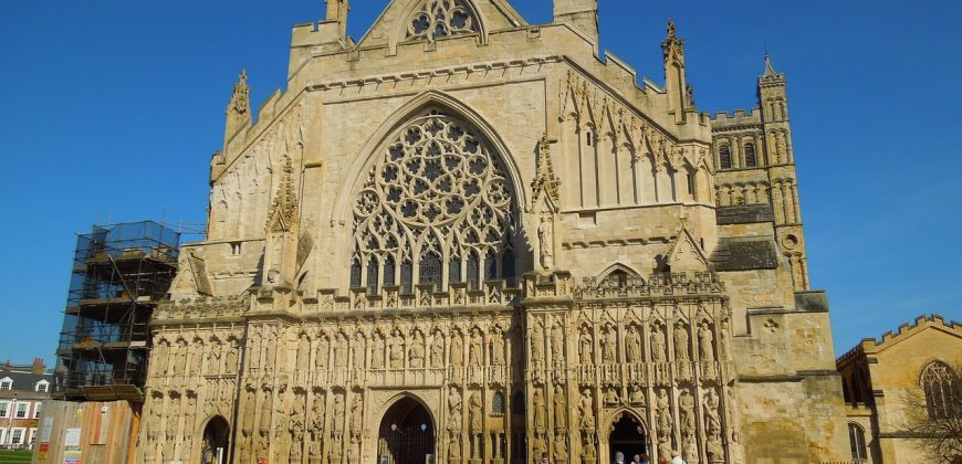Exeter cathedral, a big church with ornate stonework and windows