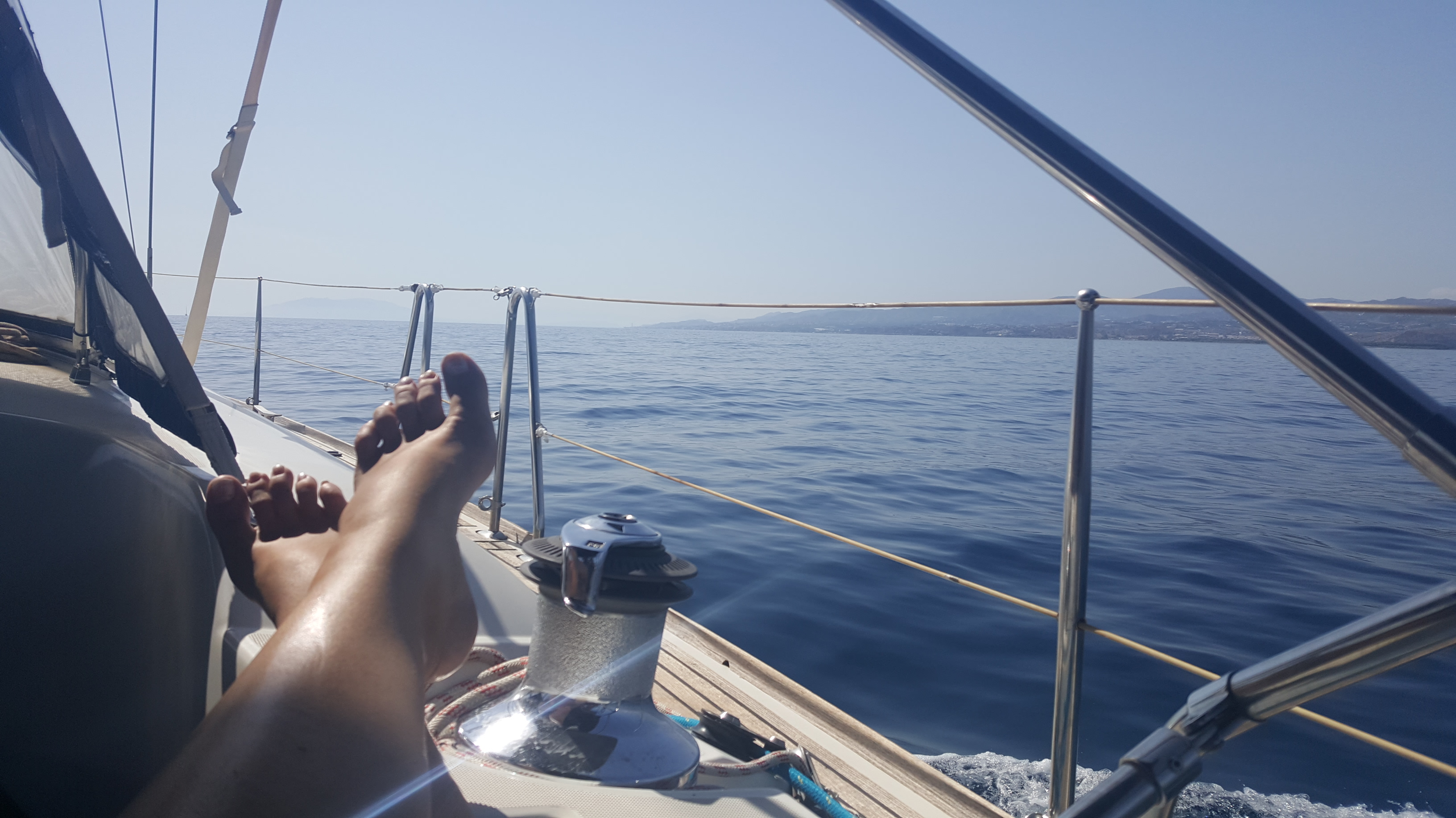 My feet up on deck, as we cruise along the southern Spanish coast, the sea is a gorgeous bright blue and the sun is streaming down