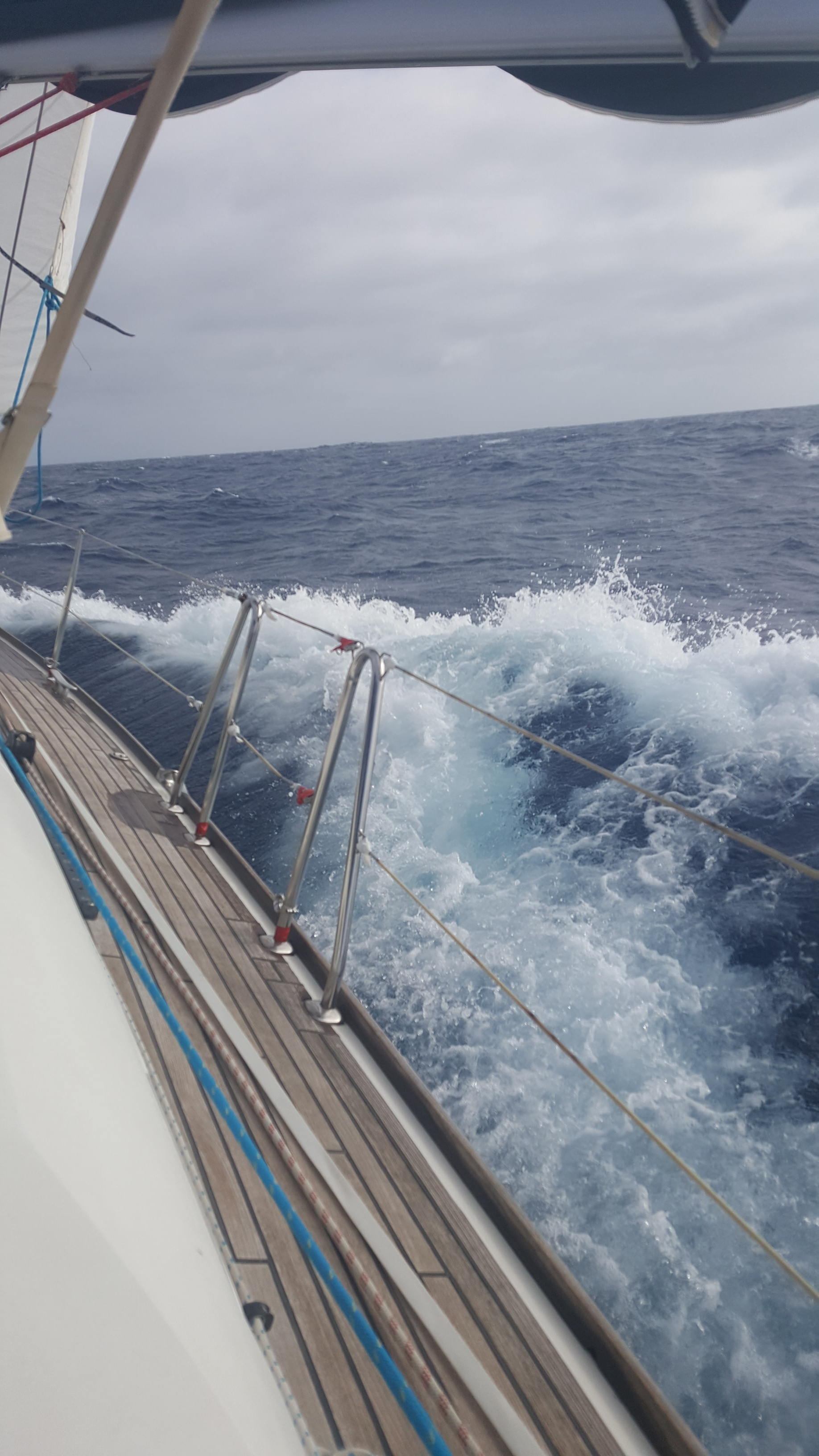 View from starboard of waves caused by the boat, we were heeled right over