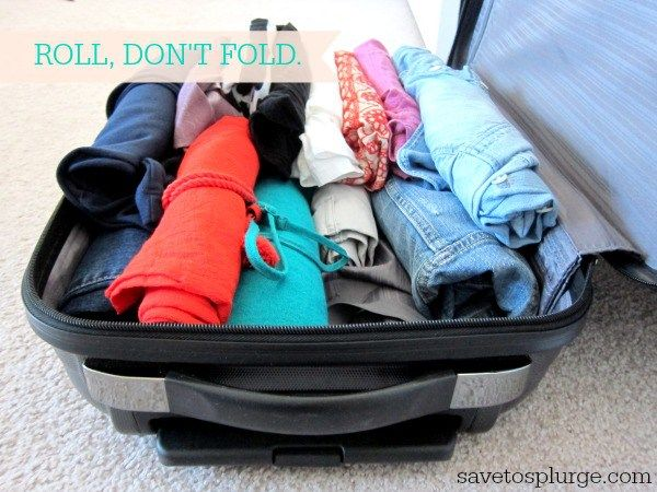 A suitcase with rolled clothes inside