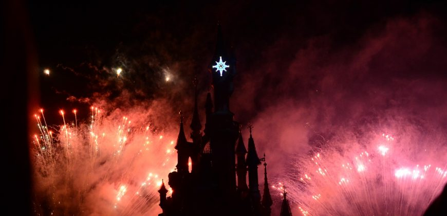 The princess castle at Disneyland, silhouetted against fireworks