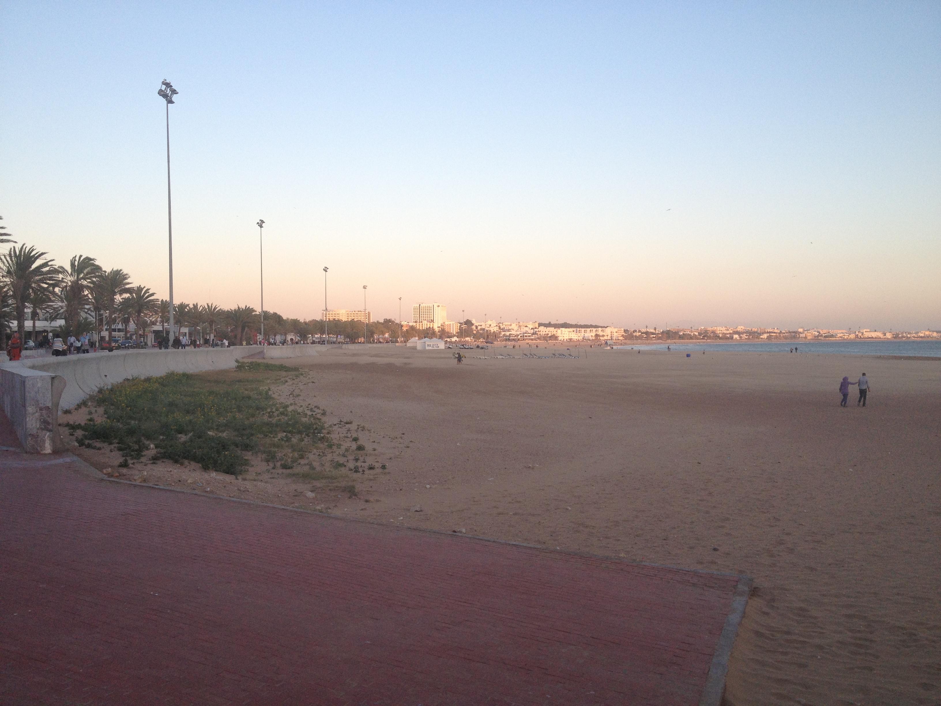 Agadir bay, a very broad sand beach bordered by a long concrete boardwalk