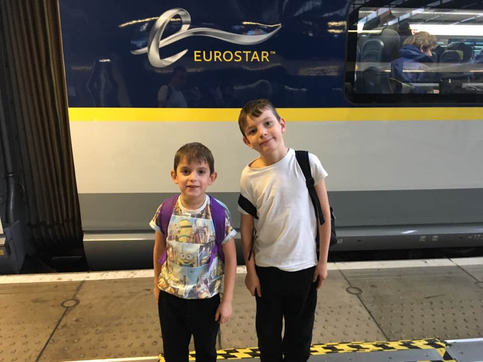 Ryan and Harvey with their backpacks on ready to board the Eurostar to Disney