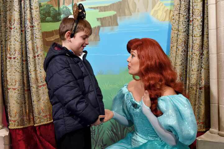 Harvey holding hands and chatting with the princess, he is looking shy and mesmerised!