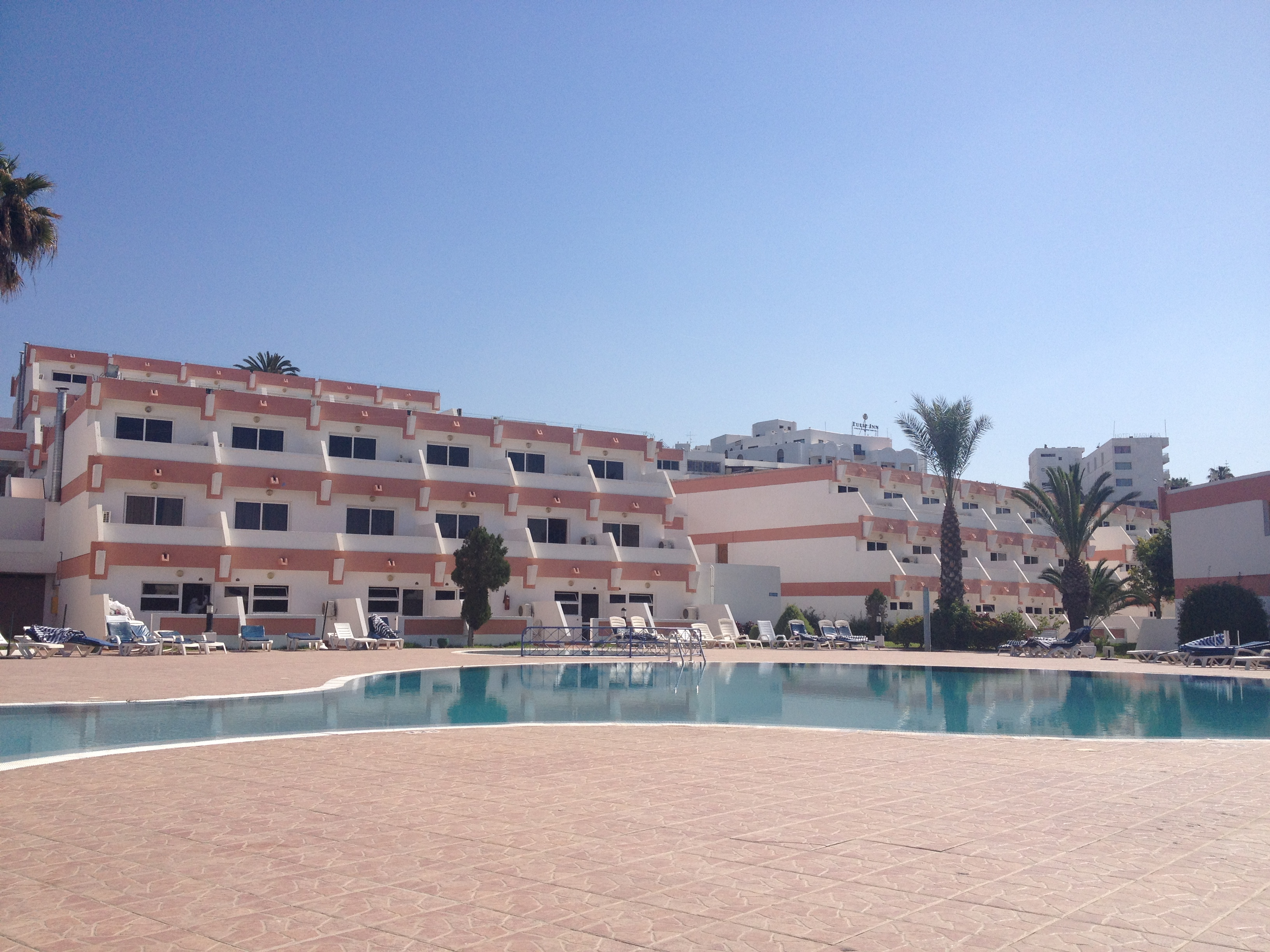 The nicer hotel rooms - 4 stories high with staggered balconies overlooking the pool