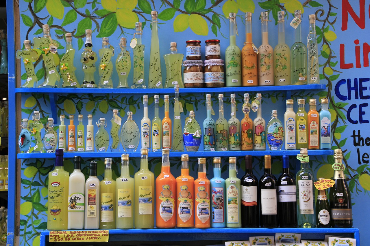 A market stand of local Italian bottled produce. Limoncello, wine and olives, all displayed in beautiful hand painted bottles featuring fruit