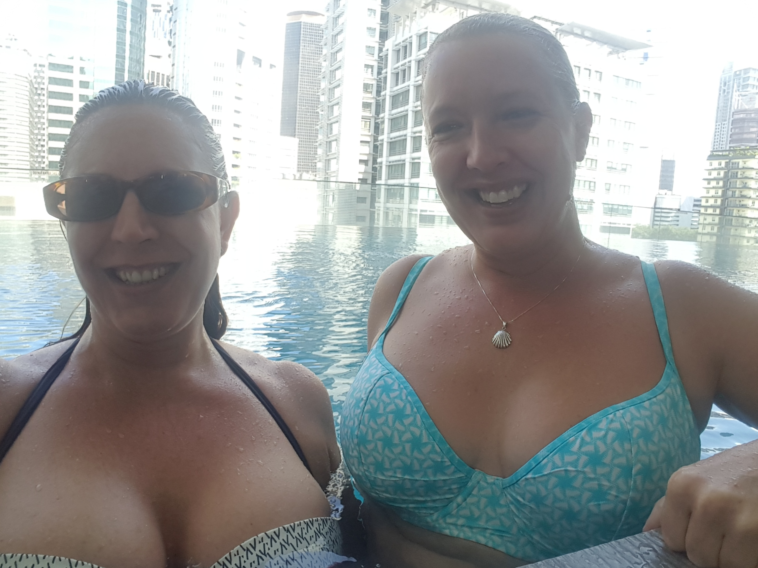 Lucy and I in bikinis in the pool, smiling