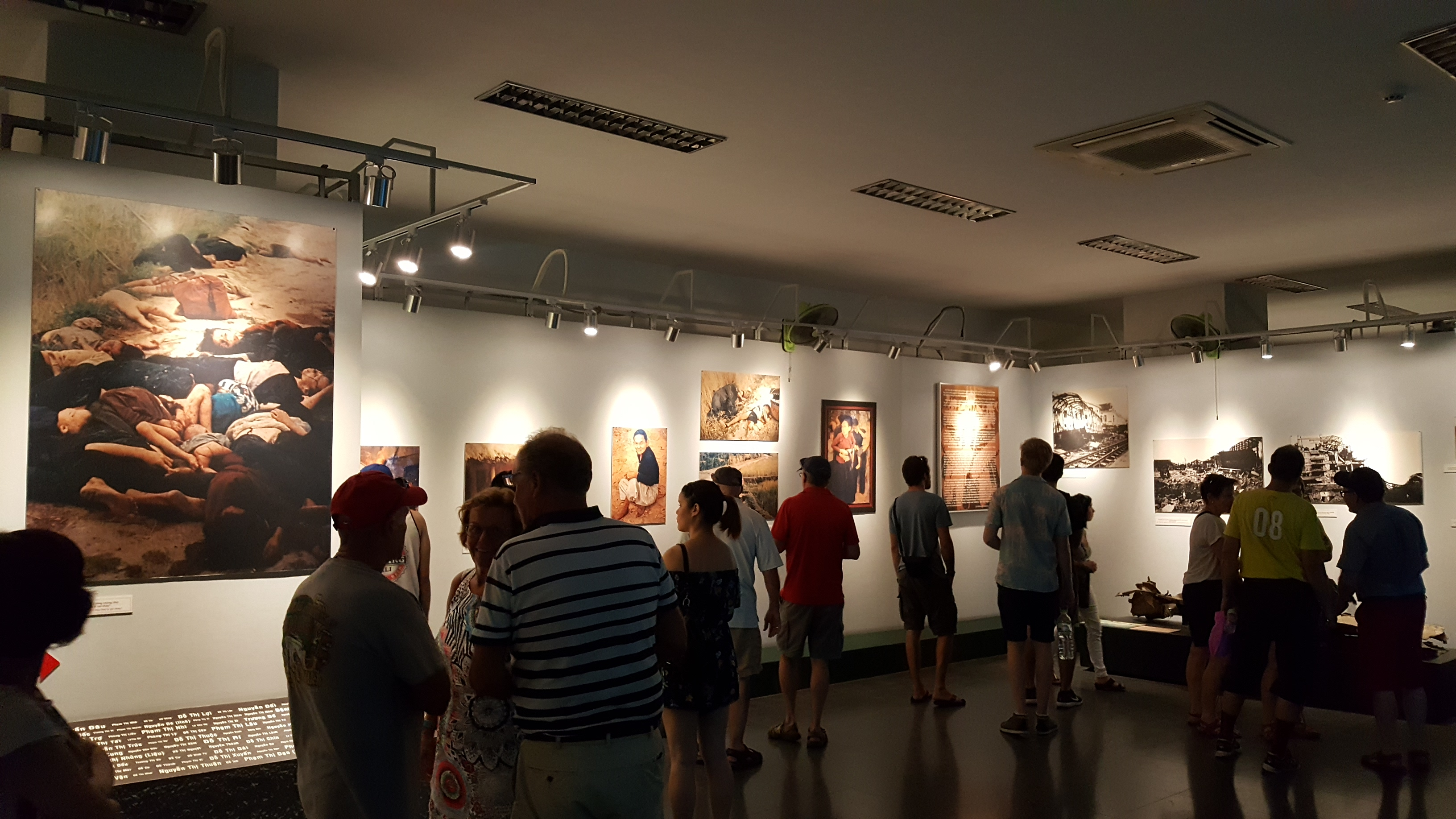 Photos displayed on the walls show war casualties and stories