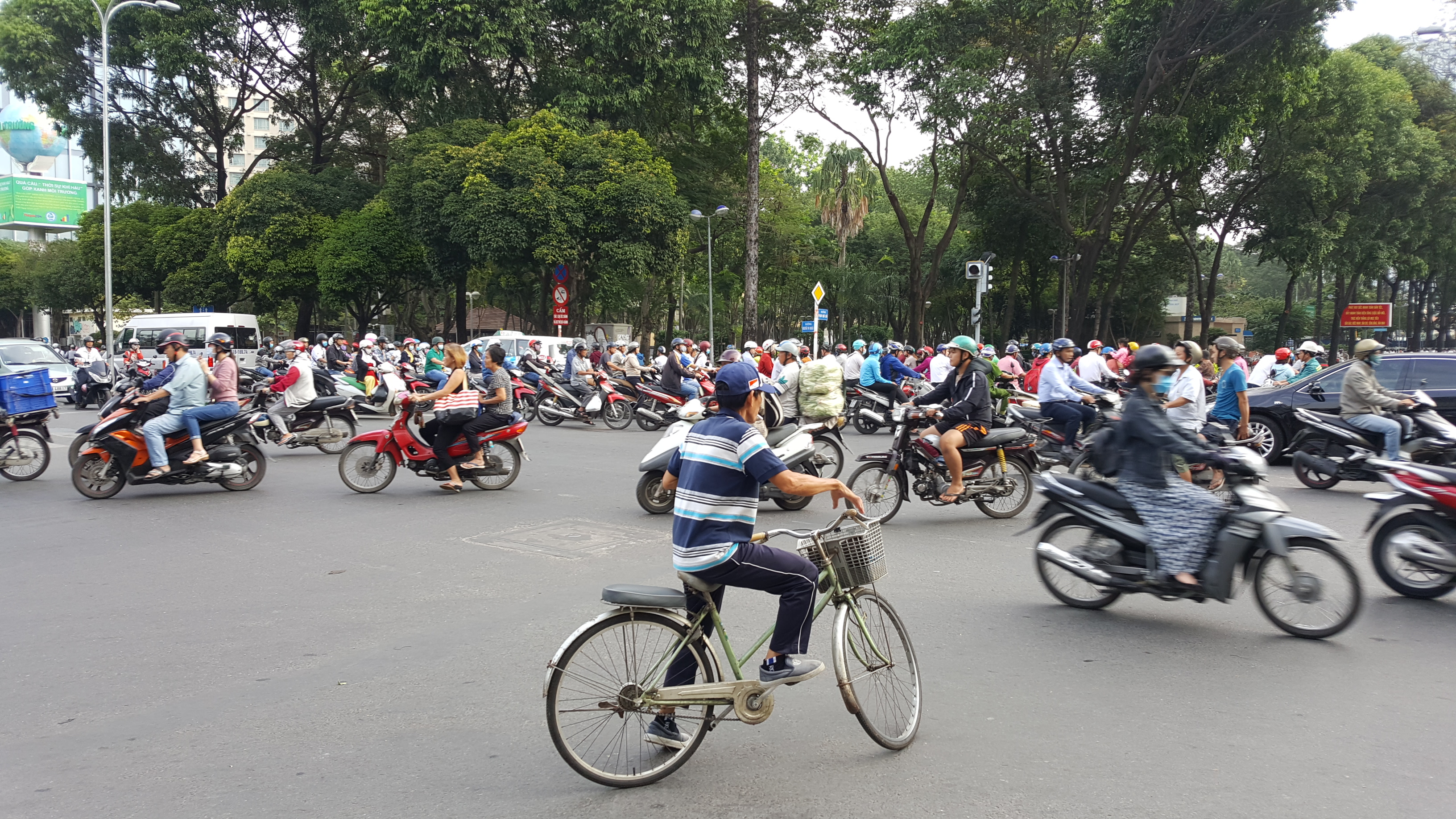 A busy junction with scooters driving in all directions