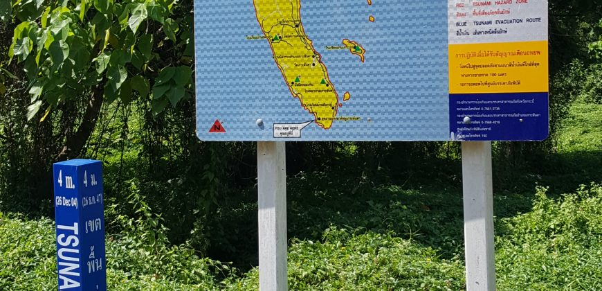 A signpost marks the spot the Tsunami of 2004 reached inland