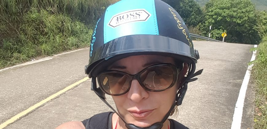 Me parked by the road wearing an old fashioned scooter helmet, trying to look moody!